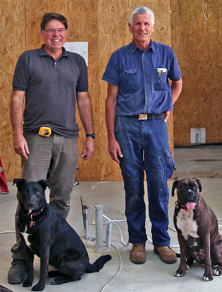 Builders Andrew Abercromby and Mark Swann with their work dogs. Picture: Gerald Moscarda  The West Australian. 01 October 2015.